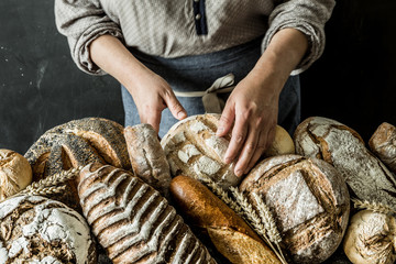 Bakery stall - rustic loaves of bread and shop assistant