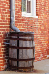 rain collection wooden barrel that is missing a stave