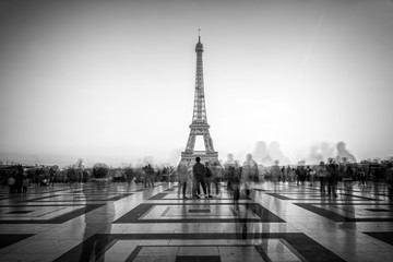 Blurred people on Trocadero square admiring the Eiffel tower, Paris, France
