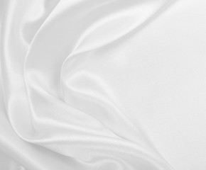 Smooth elegant white silk or satin luxury cloth texture as wedding background. Luxurious background design