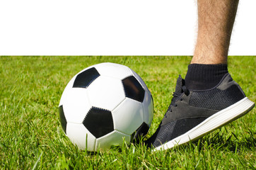 The man's leg in sneakers and soccer ball isolated white background with copy space use for sport and athletic topic