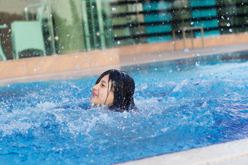 young teen girl in the pool,