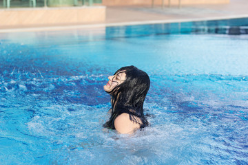 young teen girl in the pool