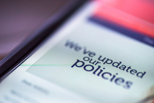 General Data Protection Regulation - GDPR - closeup smartphone message We've Updated Our Policies