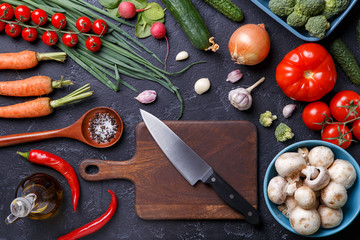 Photo on top of fresh vegetables, champignons, cutting board, oil, knife