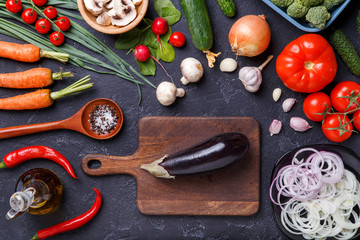Picture on top of fresh vegetables, champignons, cutting board, butter, knife, eggplant