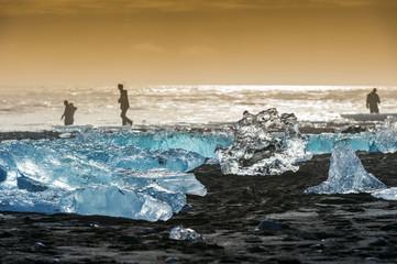 Poster Glaciers Ice on the black beach near Jokulsarlon glacier lagoon, daimond beach, Iceland.
