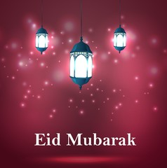 Eid Mubarak Greetings with arabic lanterns in a glowing background