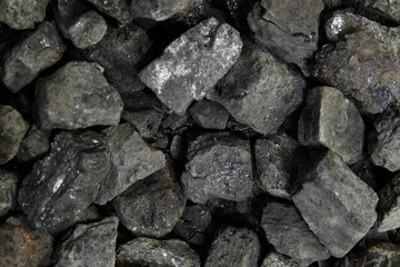 Black coal background or texture. Top view. Coal mining concept.