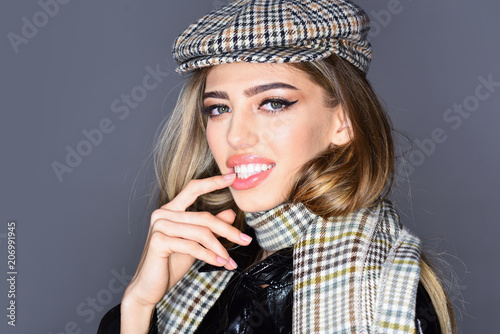 db16bf774d7 Woman on seductive face with make up with checkered accessories. Fashion  accessories concept. Girl with long hair wears plaid kepi