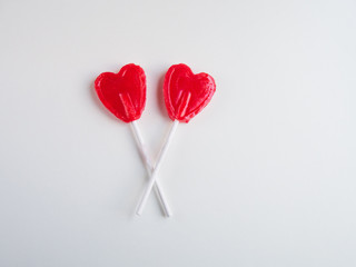 Two Red heart lollipop on white background