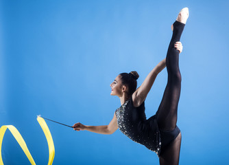 Fitness and dieting of girl gymnast. Woman train acrobatics with ribbon. Workout sports activities in gym of flexible girl. Woman with ribbon for rhythmic gymnastic. Sport success and health.