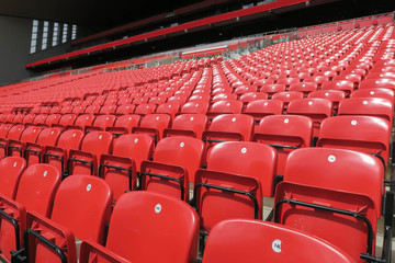 Red chair rows in football stadium.