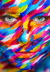 Portrait of the bright beautiful girl with painting art colorful make-up on face and bodyart. Creative vertical ads banner or flyer with copy space.