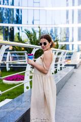 Beautiful woman walking in the summer city