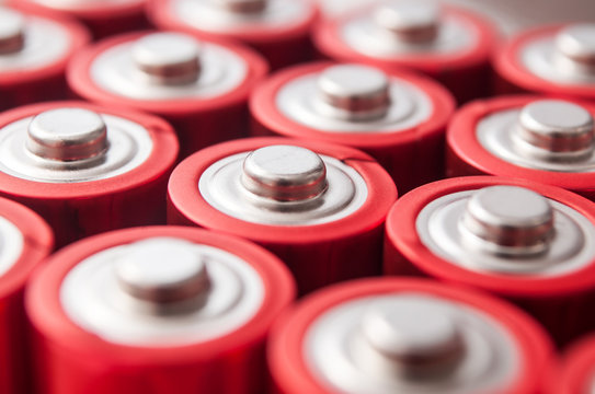 closeup of red and silver aa alkaline batteries group