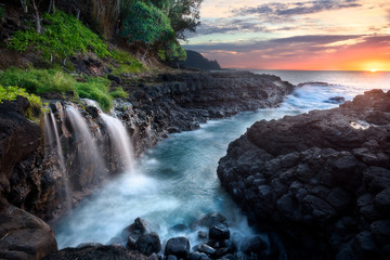 Waterfall at Queen's Bath during sunset, Kauai, Hawaii