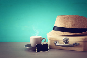 Image of cup of coffee, old box and male fedora hat over wooden table. Father's day concept.