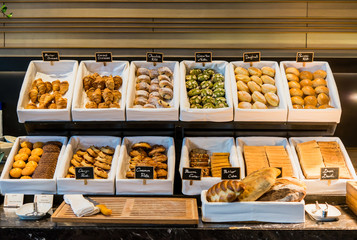 Luxury hotel breakfast buffet ,A variety of freshly made pastry in the sunlight,restaurant interior