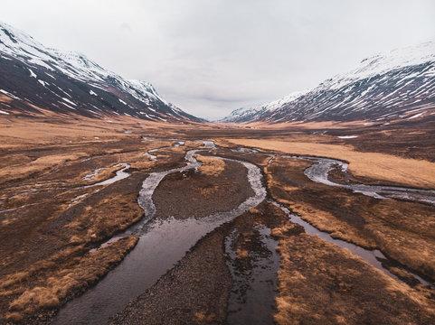 Wetland between snowy mountains