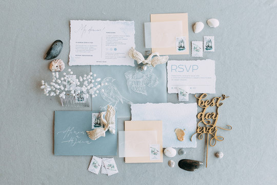 Stylish printing at the wedding ceremony, beautiful details and decor with flowers and rings. Wedding invitations made by hand with calligraphy