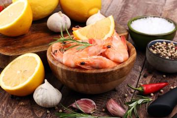 Raw fresh Prawns Langostino Austral. shrimp seafood with lemon and spices.