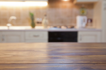 blurred kitchen interior with wooden desk space