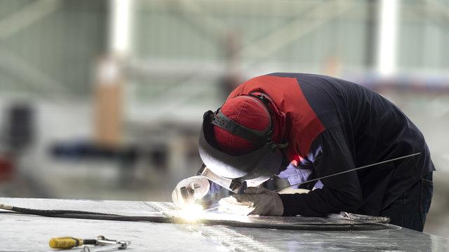 welder welding aluminum by process GTAW , Welder Industrial welding part in factory or Petrochemical , Selective focus