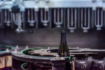 Wine bottle on corking conveyor at winery