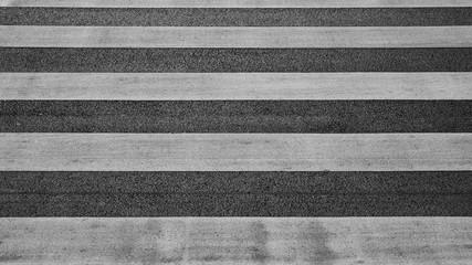 detail of a crosswalk at the asphalt road