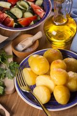 Deep-fried potatoes, salad, vegetable oil