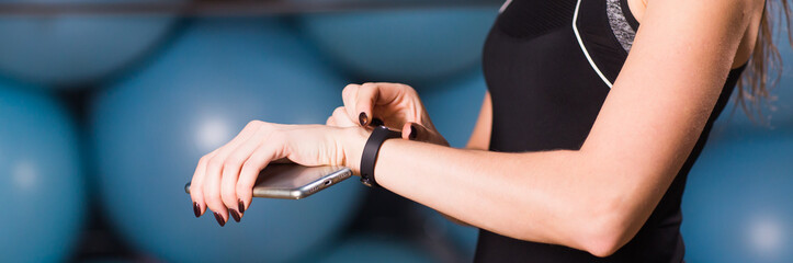 Close up of woman with fitness tracker in gym
