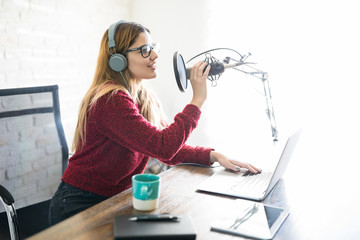 Woman podcasting a new episode