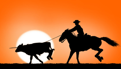 Cowboy ropes a steer