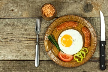 Fried egg for breakfast. Diet food. Food preparation. Fried egg on a wooden table.