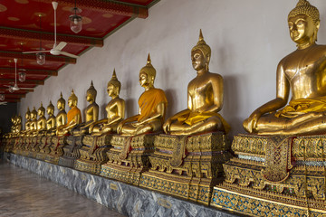 Gilded Buddha statues in Wat Pho ( Temple of the Reclining Buddha ). Bangkok. Thailand.