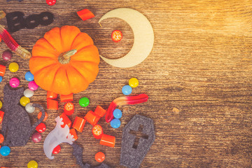 Colorful halloween candies on wood