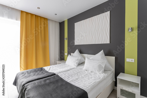 Daylight morning. hotel standart room. modern bedroom with white
