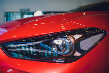 Headlights and hood sport red car with silver stars