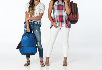 Two Young Girls Standing with a Red and Blue Backpack