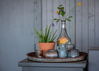 Retro still life: flower in a vase  - photo with vintage color toning. Concept of gift greeting.