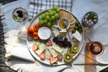 Tray of fruit, chocolate and cheese appetizers