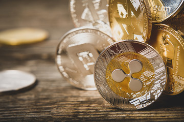 Cryptocurrency, souvenir coins of Ripple Monero Dash Litecoin Bitcoin Ethereum on wooden surface, macro with copy space for text