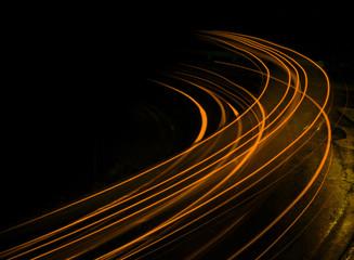 Long exposure at night orange streaks Fotobehang