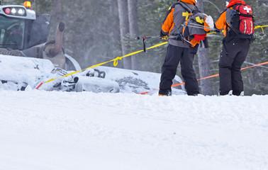 First aid ski patrol pulled up ski run