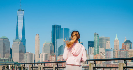 Beautiful woman is walking in sunny day in New York.