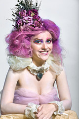 Beautiful girl with purple hair. Bright makeup