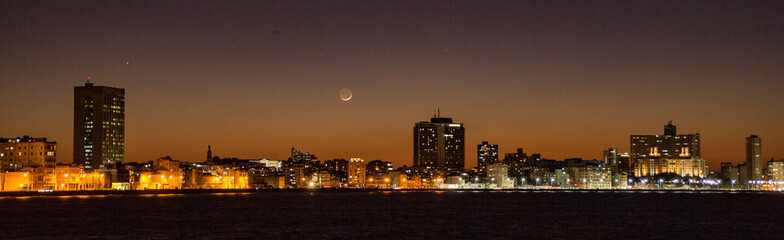 Havana skyline at sunset, with crescent moon