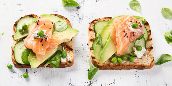 Toast with avocado, cucumber and  salmon