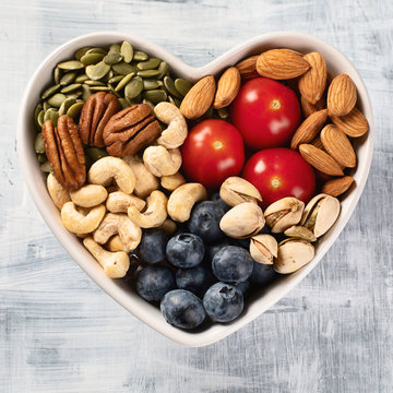 Healthy snack in heart shaped bowl